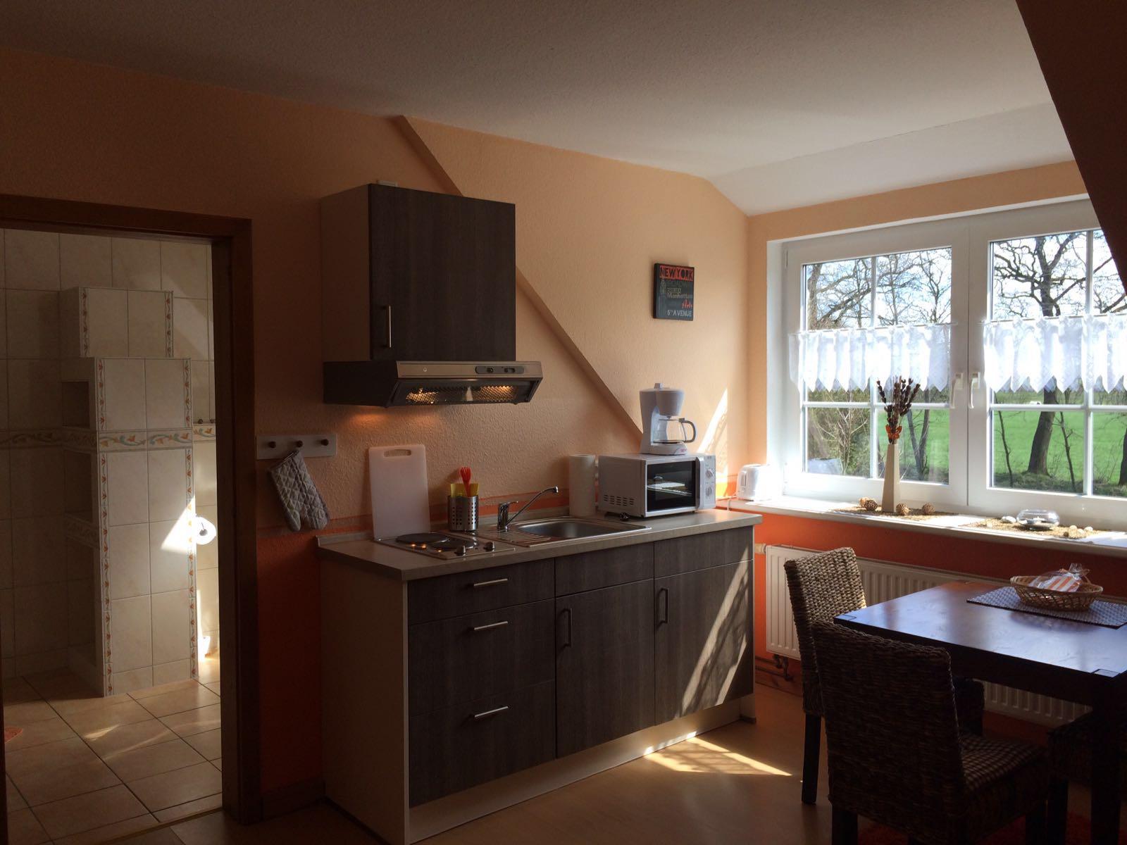 Haus Friesenglück in Kolkerheide, Nordfriesland – Ferienwohnungen und Ferienapartments – Ferienapartment 1 (braun/orange) – Innenansicht 1